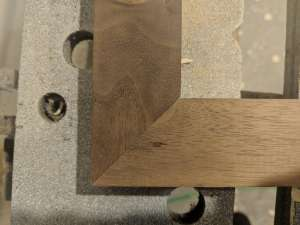 Two pieces of walnut meeting at a perfect right angle with no gaps