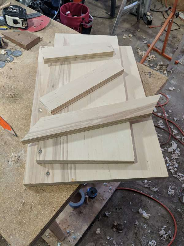 The pieces for a plywood shooting board