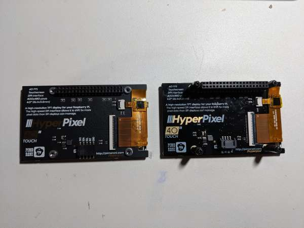 The board from Adafruit was glossy, Pimoroni's was matte