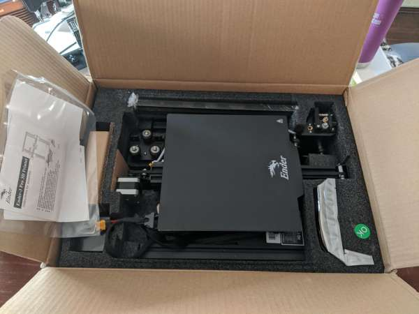 An open box showing the lower half of the printer